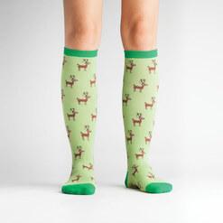 model wearing Reindeer Games - Santa's Reindeer Knee High Socks Green - Women's