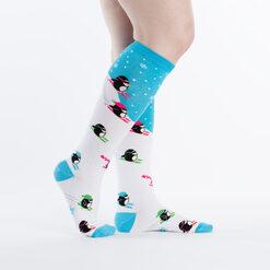 model side view of Downhill Penguins - Skiing Penguin Friends Knee High Socks White - Women's