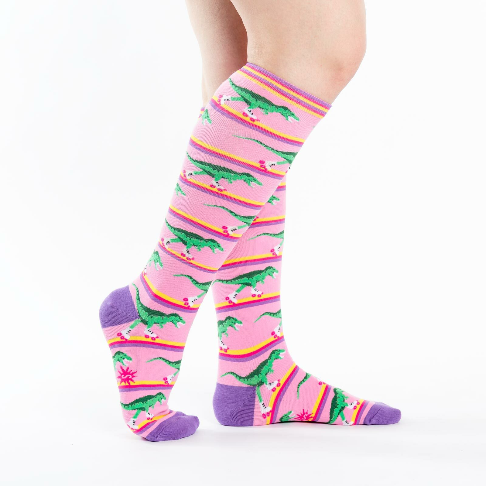 model side view of Rawr-ler Rink - Dinosaur Knee High Socks - Women's