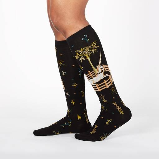 model wearing Unicorn in Captivity - Unicorn Tapestries Painting Knee High Socks Black - Women's