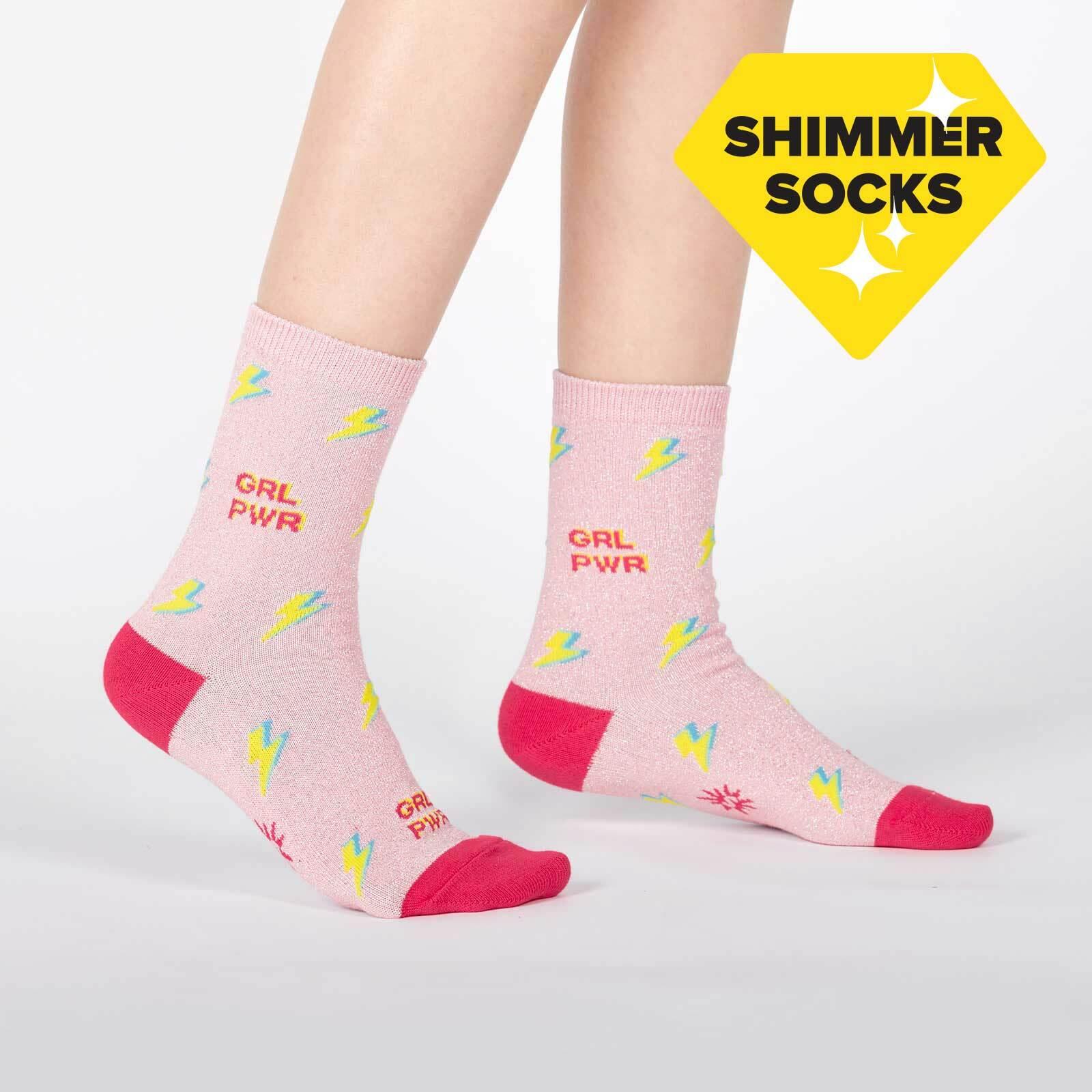 model wearing United We Shine - Sparkling Shimmer Girl Power Lightning Crew Socks Pink - Junior's