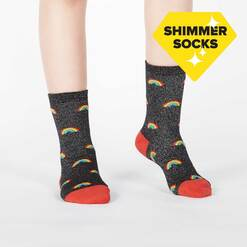 model wearing Glitter Over The Rainbow - Sparkling Shimmer Rainbow Beam Crew Socks Black - Junior's