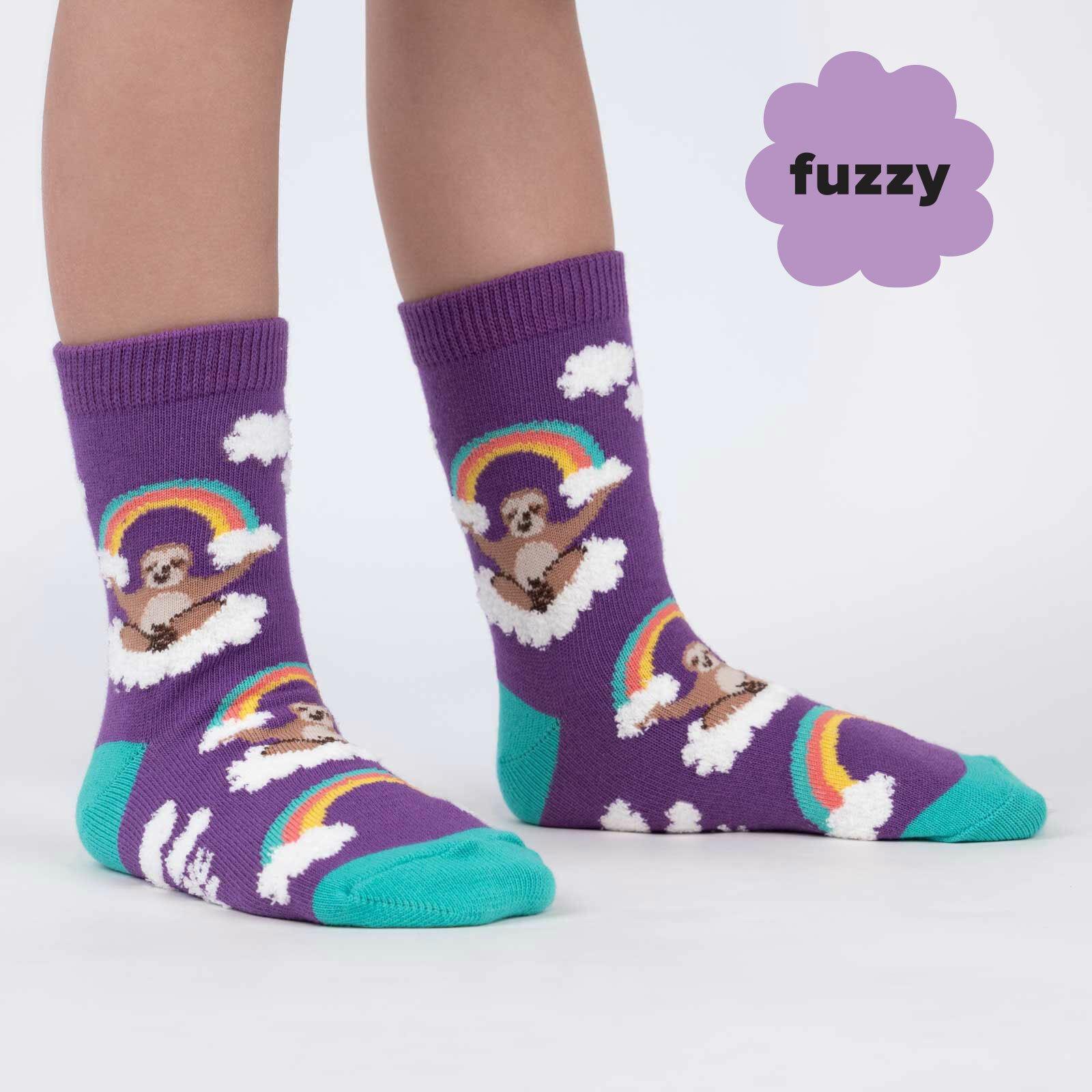 model wearing Sloth Dreams - Fuzzy Happy Rainbow Sloth Crew Socks Purple - Junior