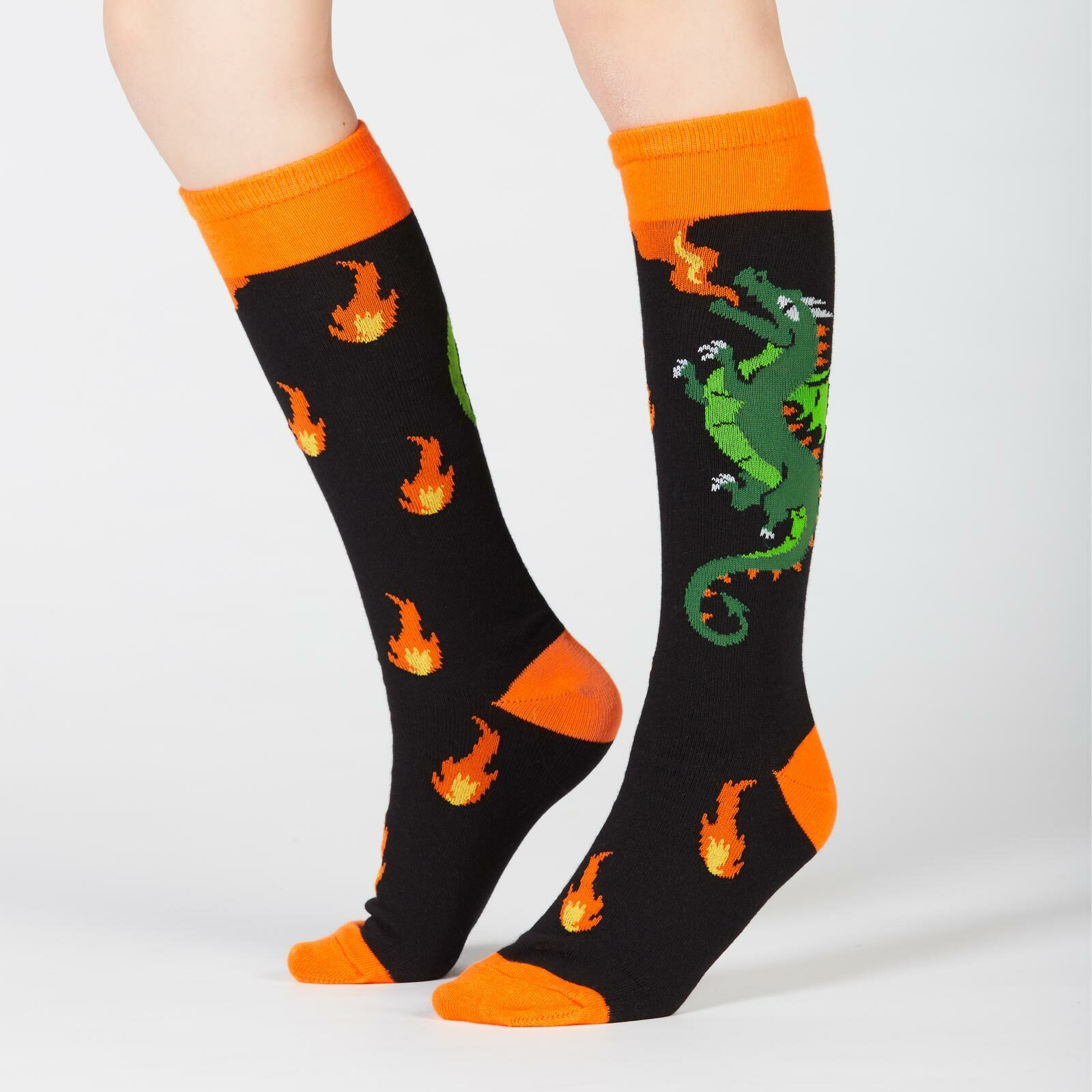 model side view of Spitfire - Dragon Knee High Socks Black and Orange - Junior