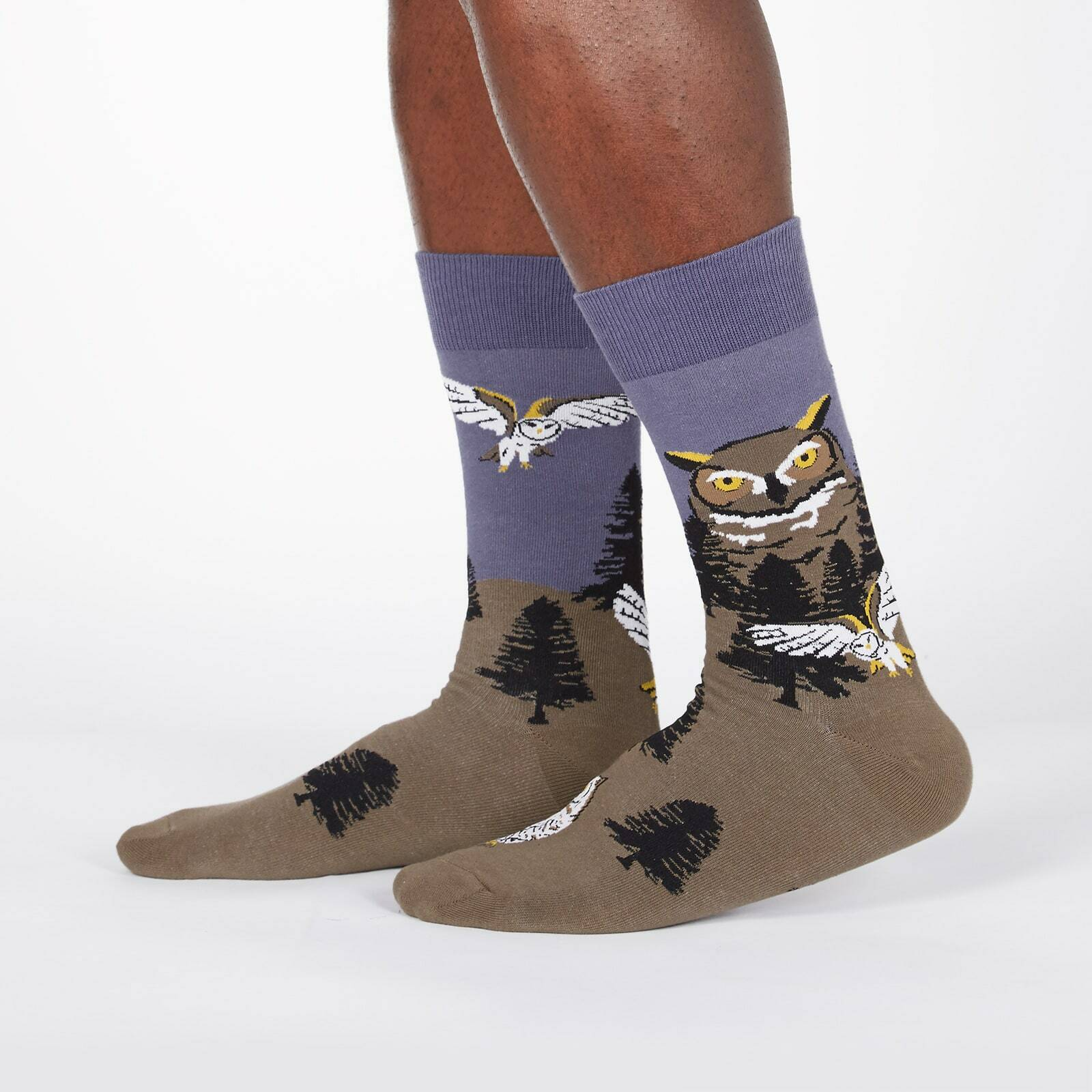 model wearing Owl Mountain - Great Horned Owl Barn Owl Nature Crew Socks Green - Men's