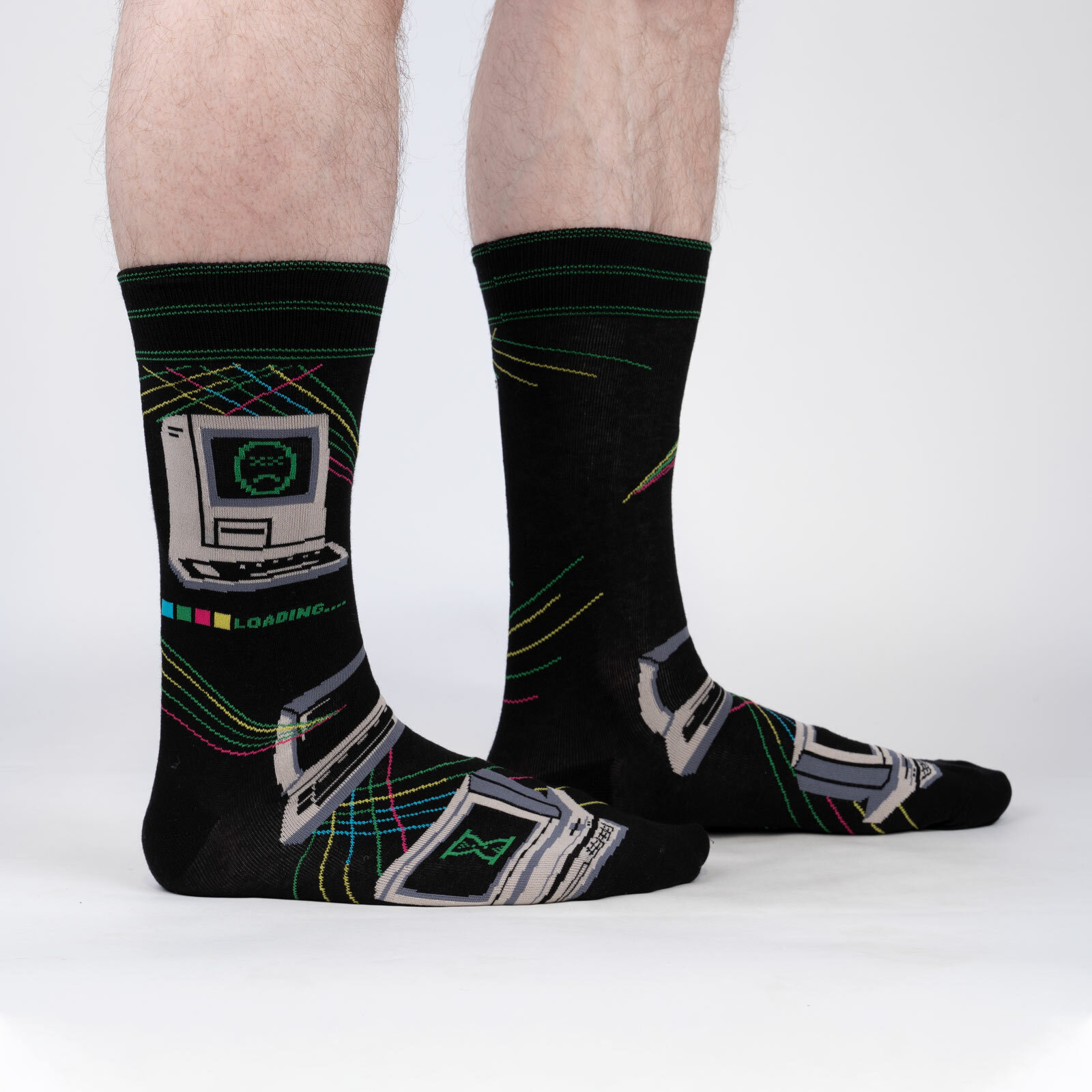model wearing Control Alt Delete - Retro Computer Crew Socks Black - Men's