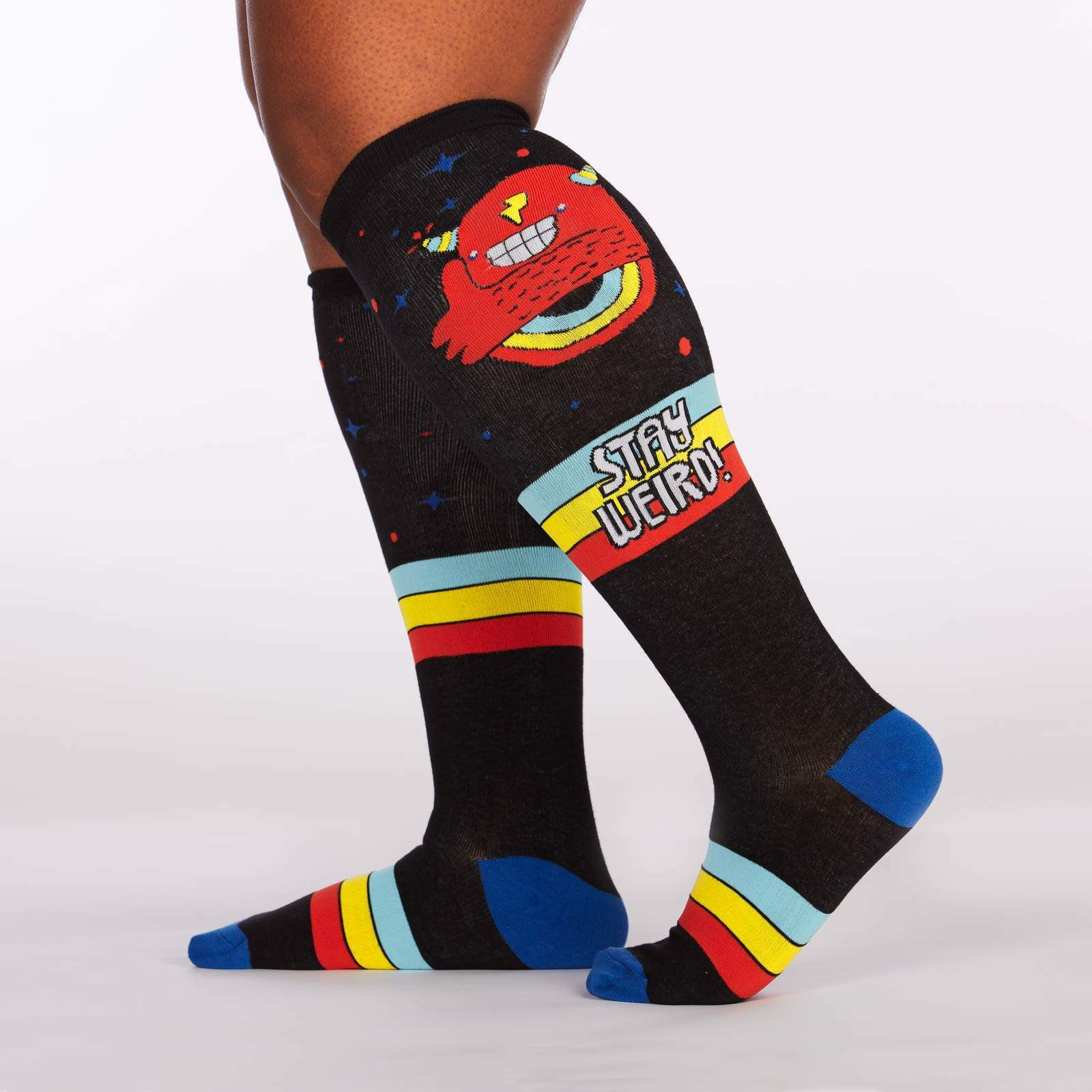 model side view of Stay Weird - Wide Calf - Statement Knee High Socks Black - Unisex