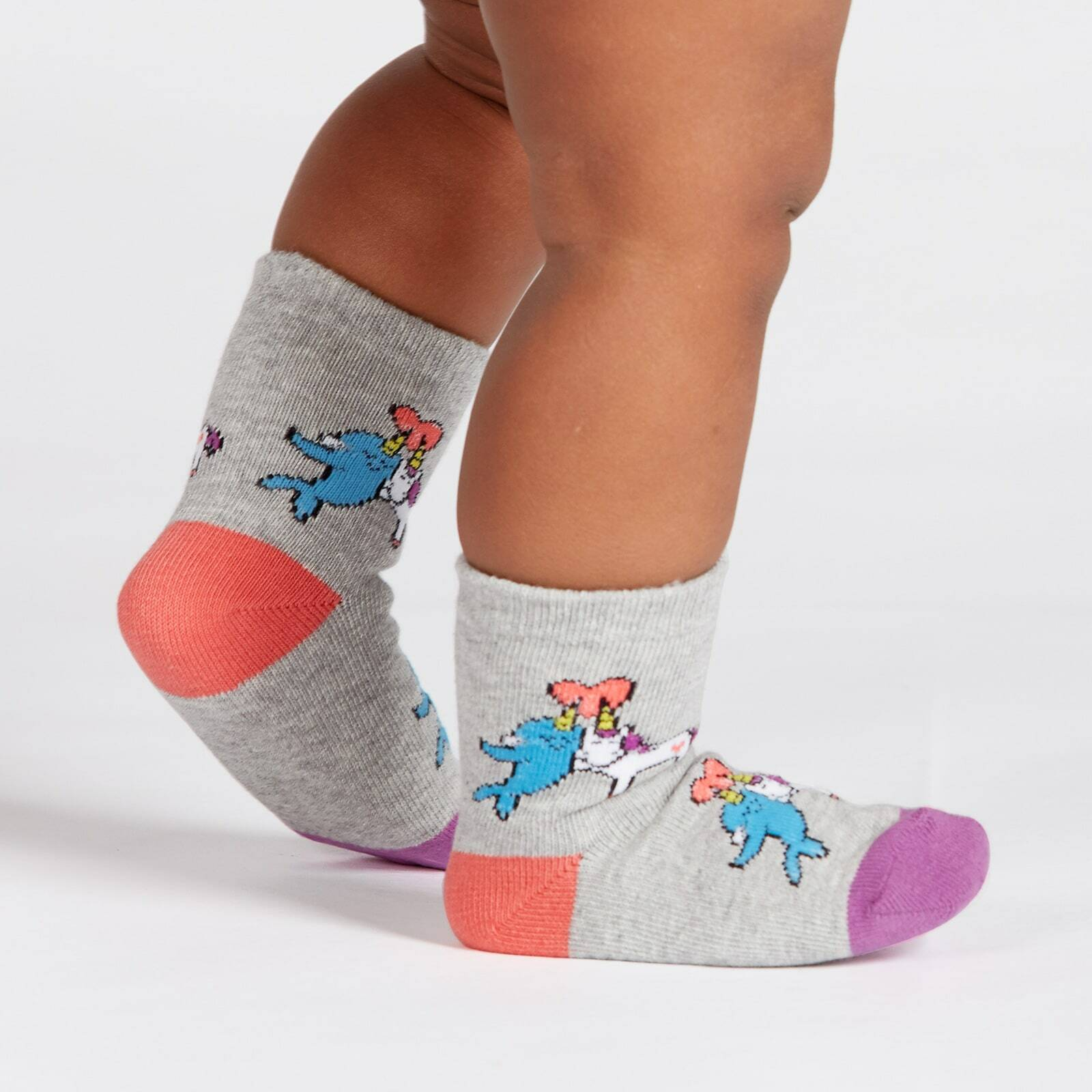 model side view of Great Horns Think Alike - Unicorn Narhwal Crew Socks Grey - Toddler