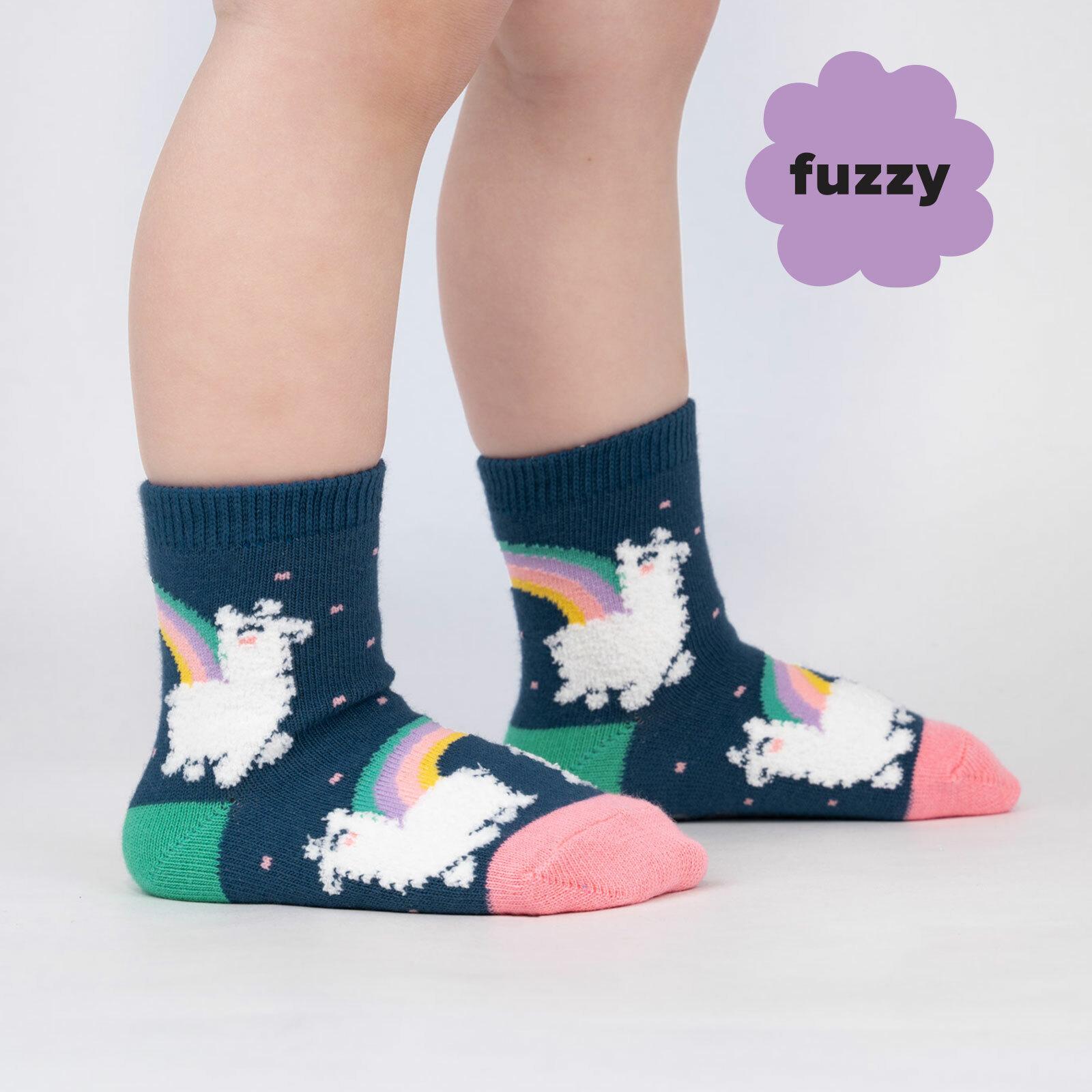 model wearing Llam-where Over The Rainbow - Fuzzy Happy Rainbow Llama Crew Socks Blue - Toddler