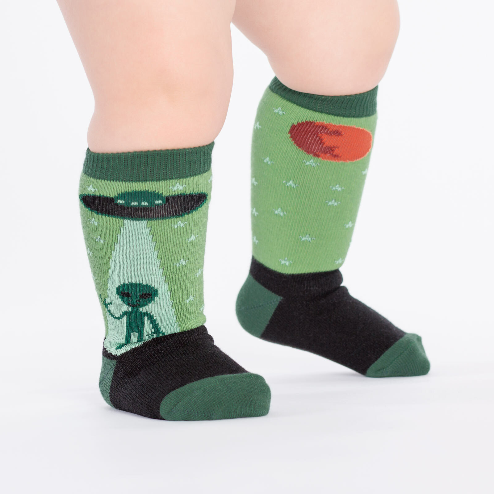 model wearing I Believe - Alien Knee High Socks Green - Toddler