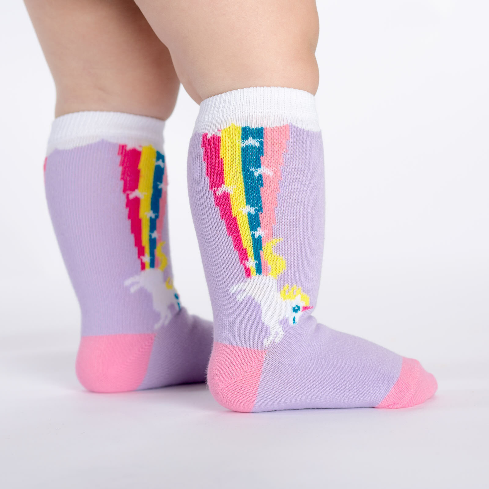 model side view of Rainbow Blast - Rainbow Unicorn Socks - Toddler