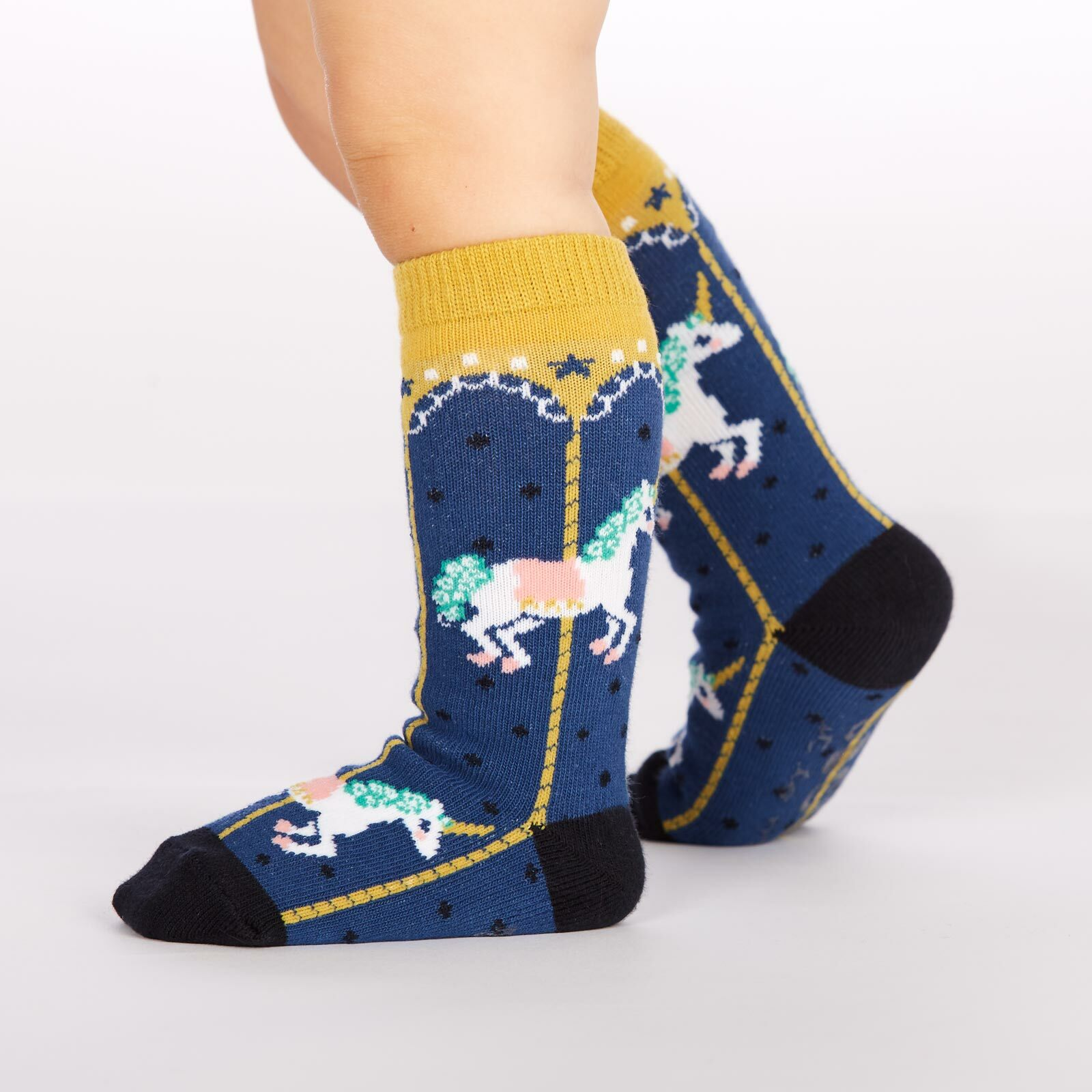 model side view of Carousel Knee High Socks Blue and Yellow - Toddler