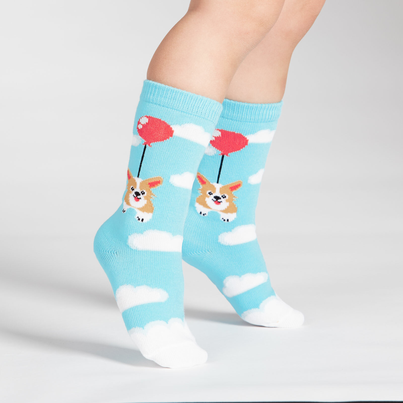 model side view of Pup, Pup, and Away Corgi Crew Socks Blue - Toddler