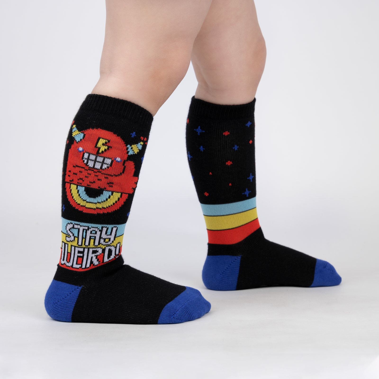 model wearing Stay Weird - Crazy Monster Knee High Socks Black - Toddler