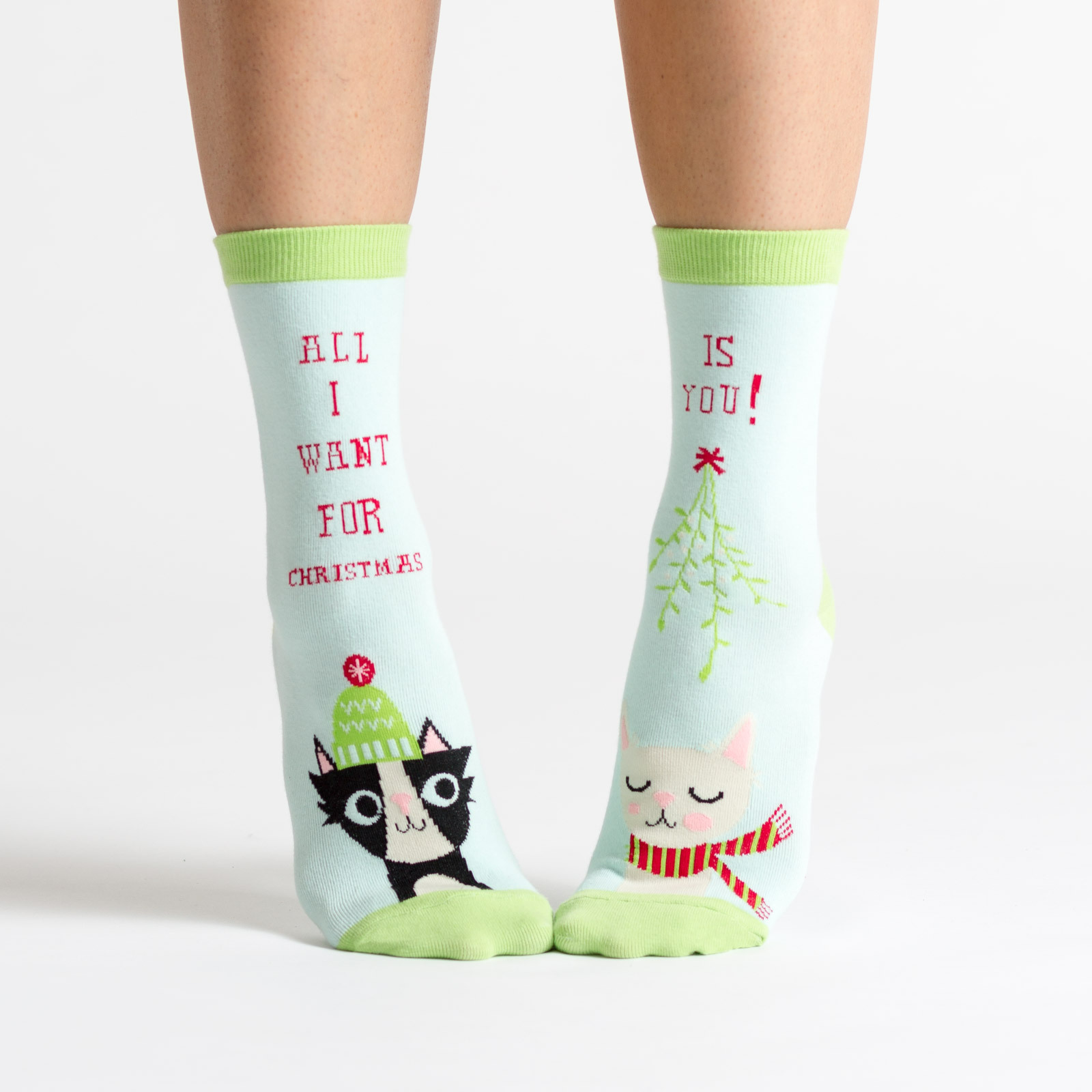 model wearing All I Want For X-mas - Holiday Cats Crew Socks Baby Blue - Women's