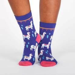 model wearing ¿Cómo Te Llamas? - Llama Crew Socks Blue - Women's