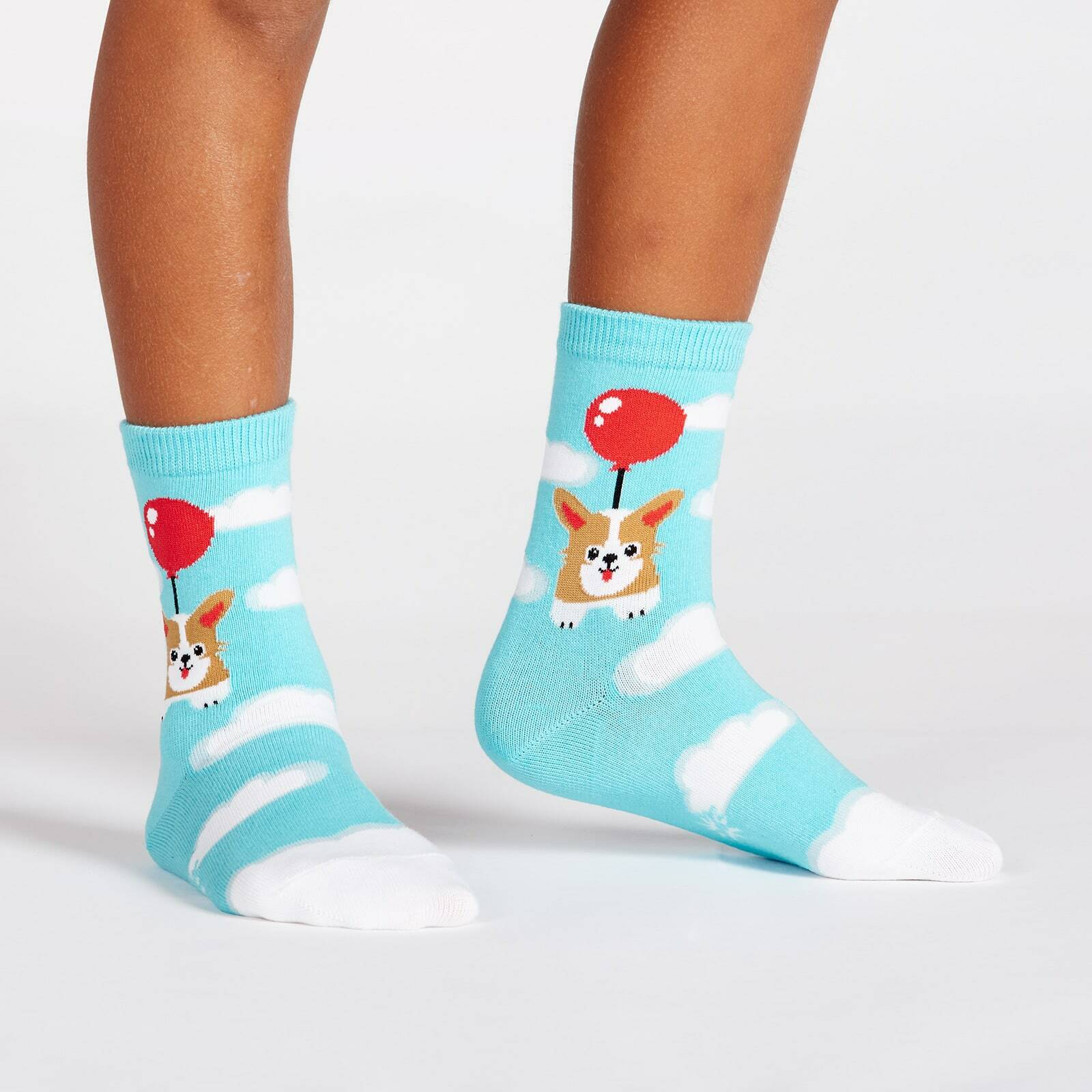 model wearing Pup, Pup, and Away Corgi Crew Socks Blue - Youth