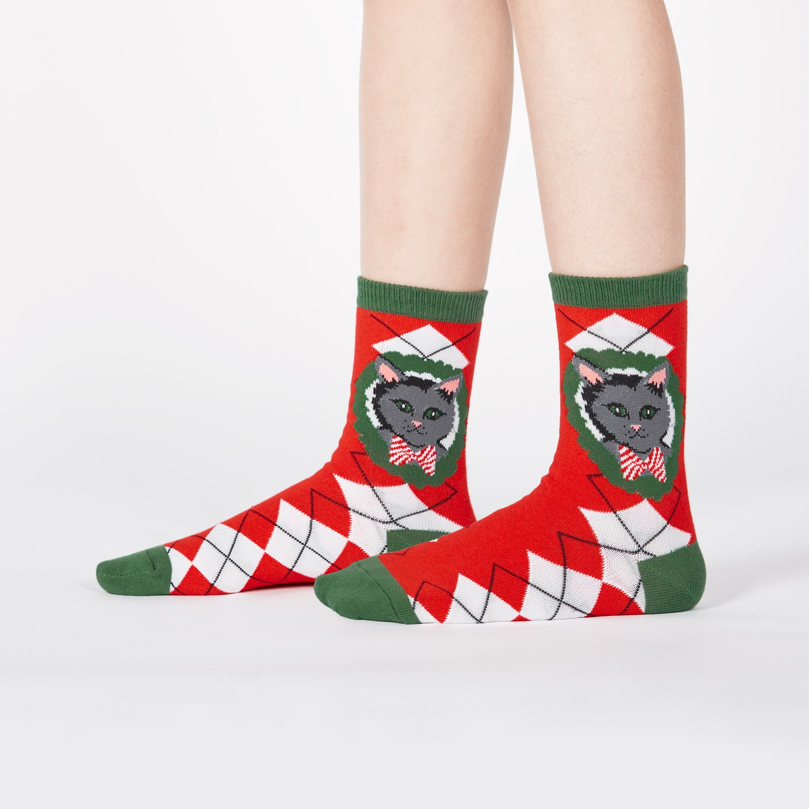 model wearing Deck the Paws - Dog and Cat Holiday Argyle Christmas Crew Socks Red - Youth