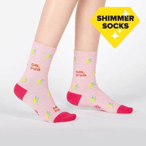 model wearing United We Shine - Sparkling Shimmer Girl Power Lightning Crew Socks Pink - Youth