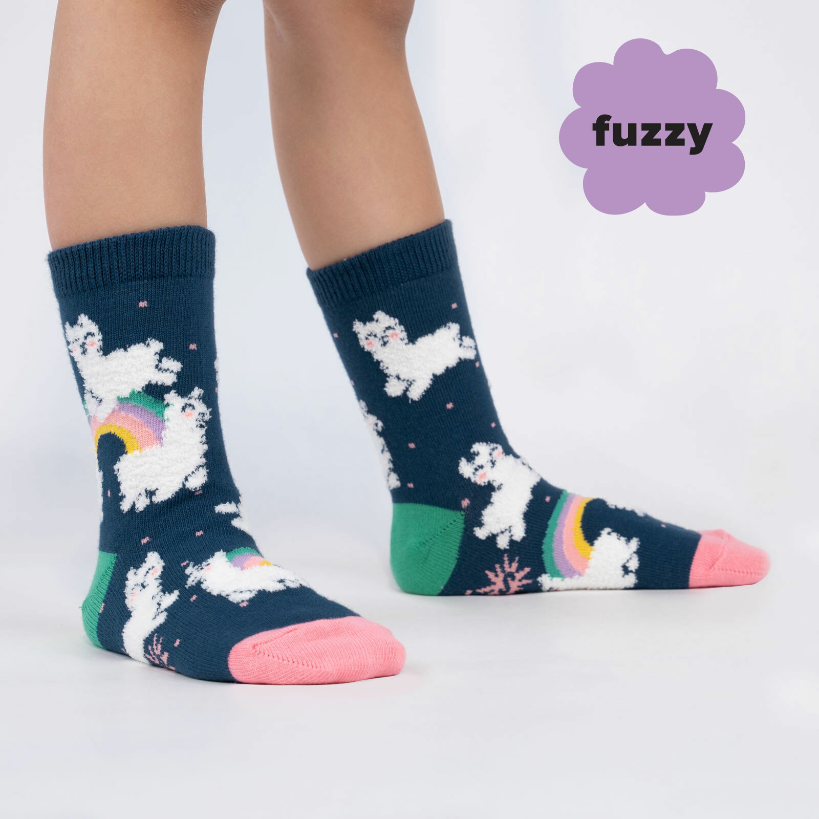 model wearing Llam-where Over The Rainbow - Fuzzy Happy Rainbow Llama Crew Socks Blue - Youth