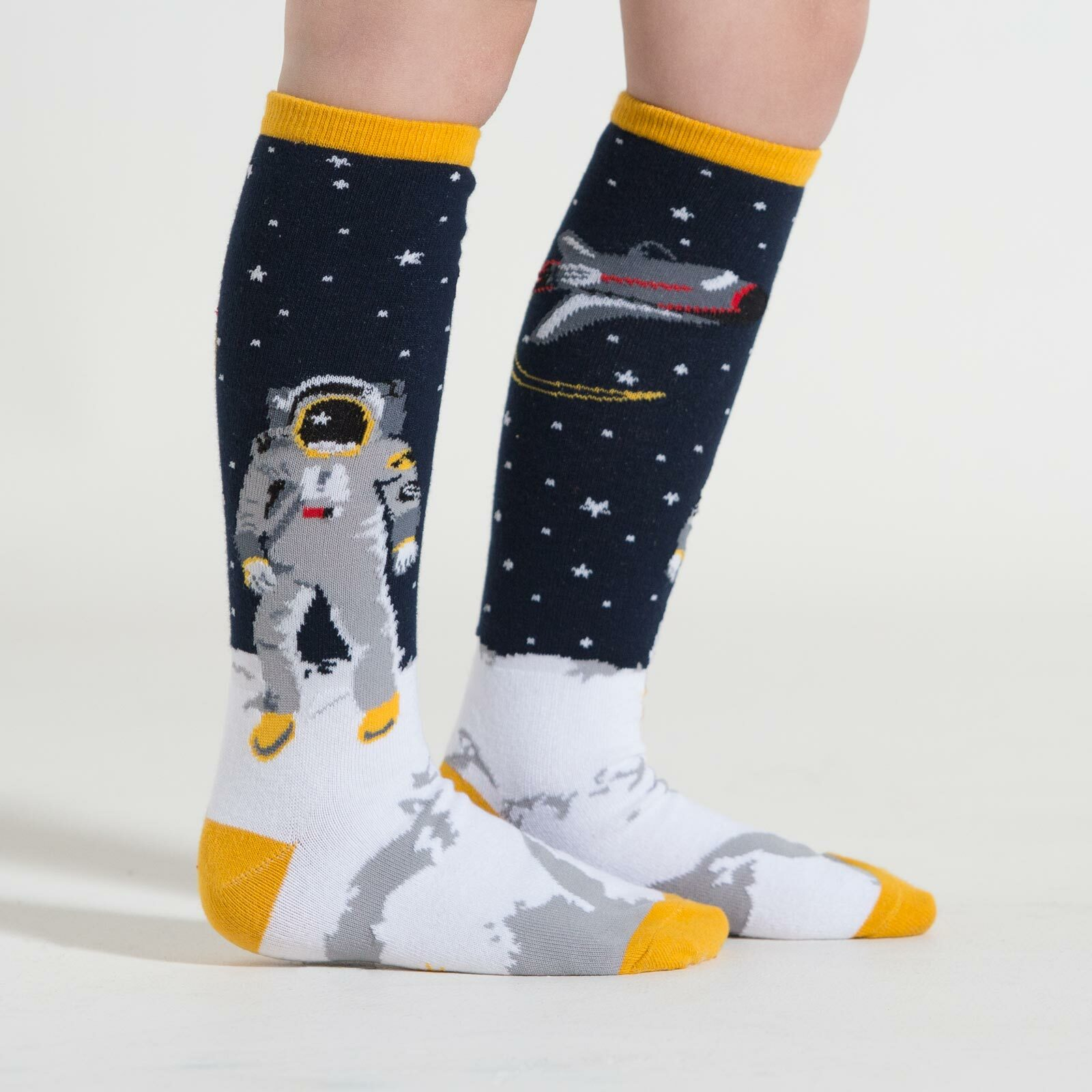 model side view of One Small Step - Outer Space Knee High Socks Blue - Youth