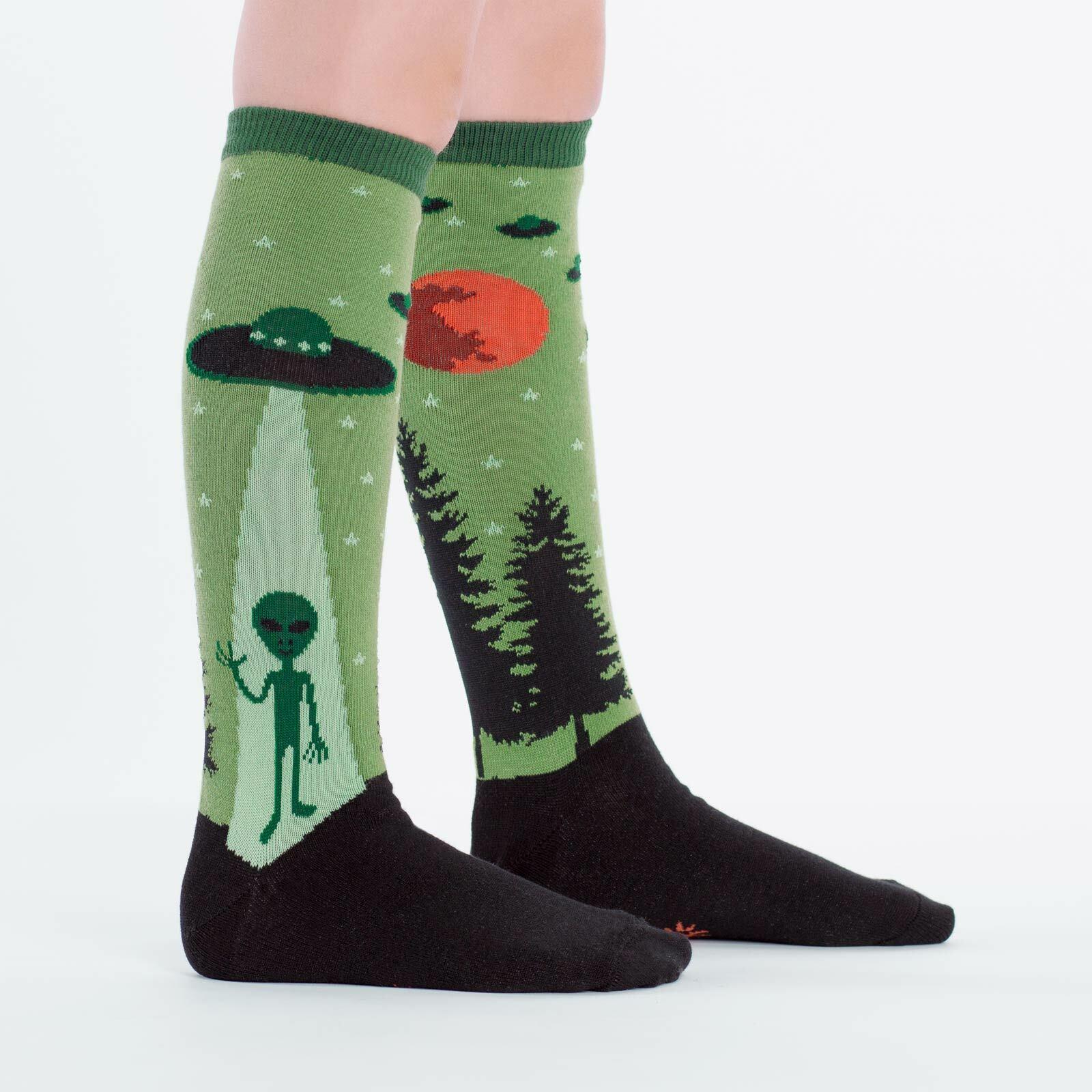model side view of I Believe- Alien Knee High Socks Green - Youth