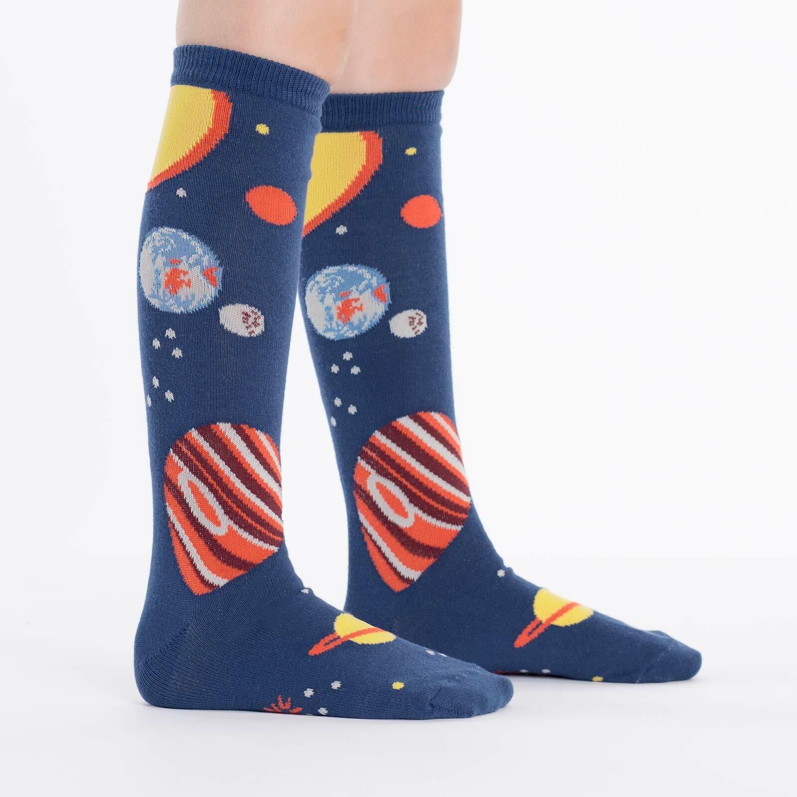 model side view of Planets - Outer Space Knee High Socks Blue - Youth