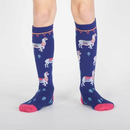 model wearing ¿Cómo te Llamas? - Llama Knee High Socks - Youth