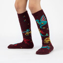 model wearing Beasts of Yore - Mythical Dragon and Griffin Knee High Socks Maroon - Youth