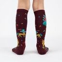model rear view of Beasts of Yore - Mythical Dragon and Griffin Knee High Socks Maroon - Youth