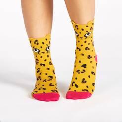 model wearing Chee-Toes - Pop-Up Ears - Cheetah Crew Socks Orange - Women's