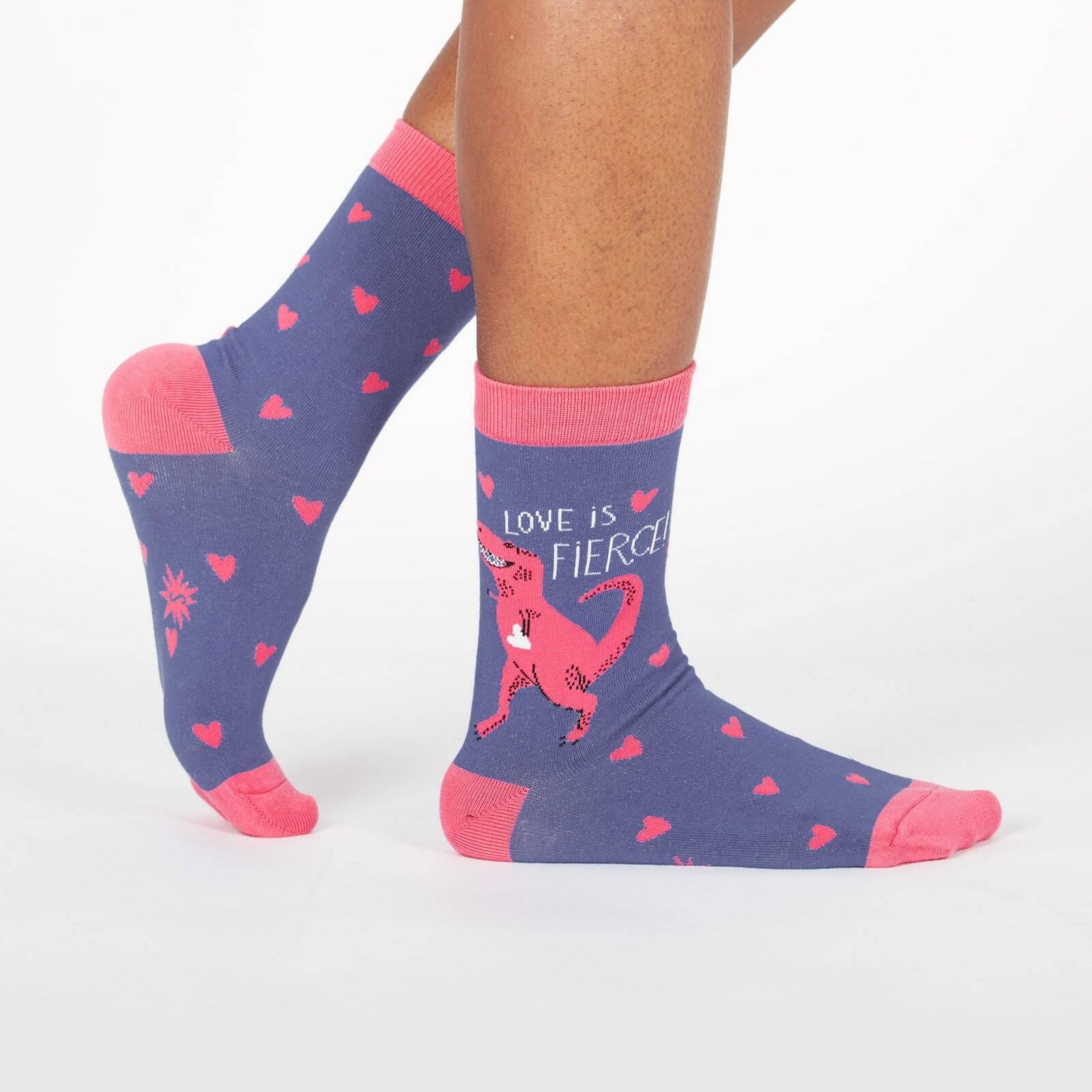 model wearing Love Is Fierce - T-Rex Dinosaur and Hearts Crew Socks Blue - Women's