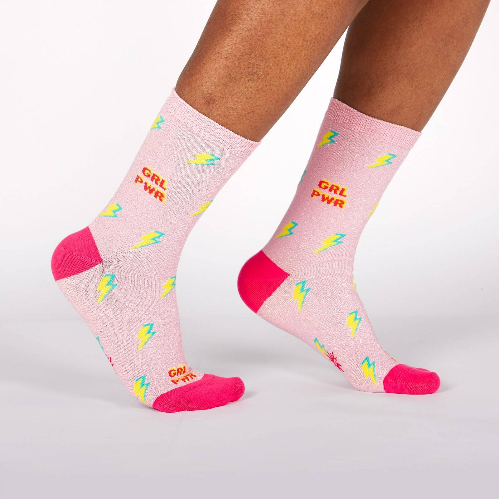 model wearing United We Shine - Sparkling Shimmer Girl Power Lightning Crew Socks Pink - Women's
