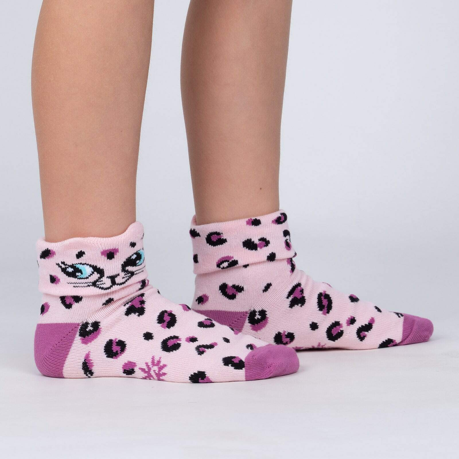 model side view of Check Meowt - Pink Leopard Turn Cuff Socks - Youth
