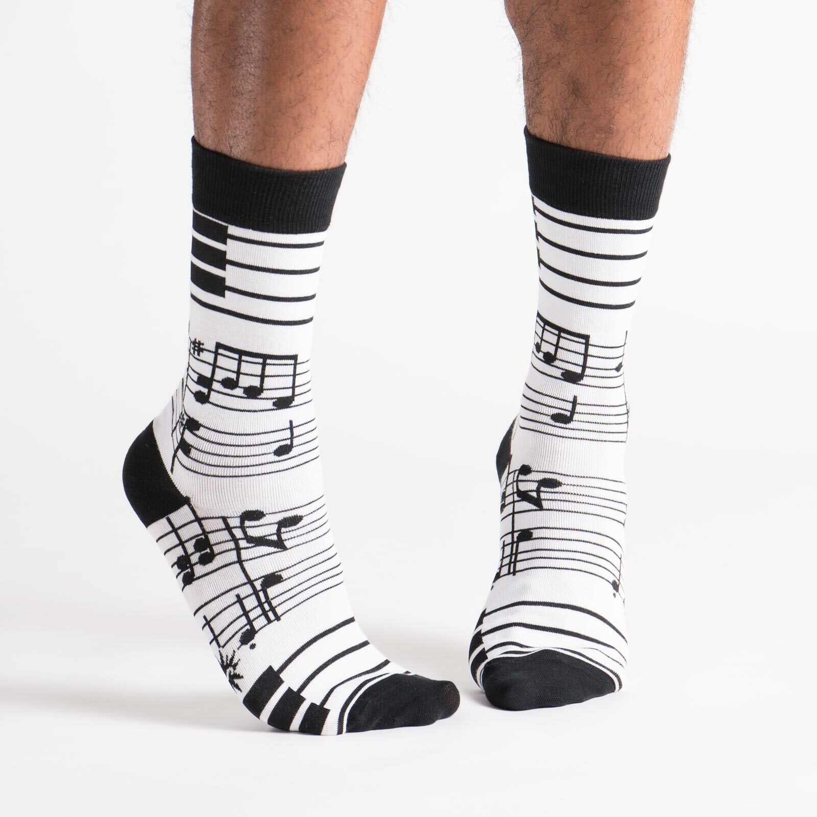 model wearing Footnotes - Music Crew High Socks Black and White - Men's