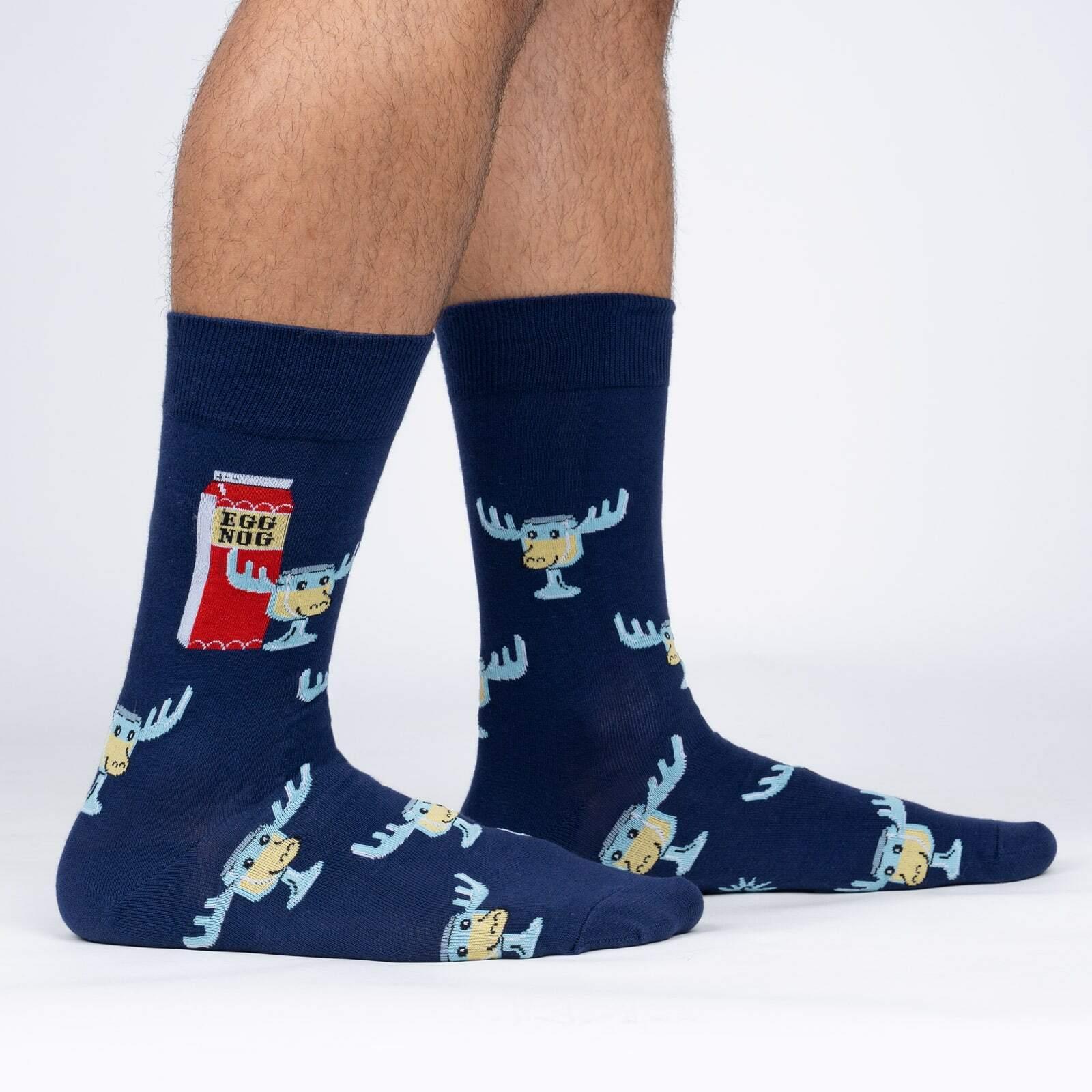 model side view of Hey, Kids! Look! A Moose! - Christmas Movie Eggnog Crew Socks Blue - Men's
