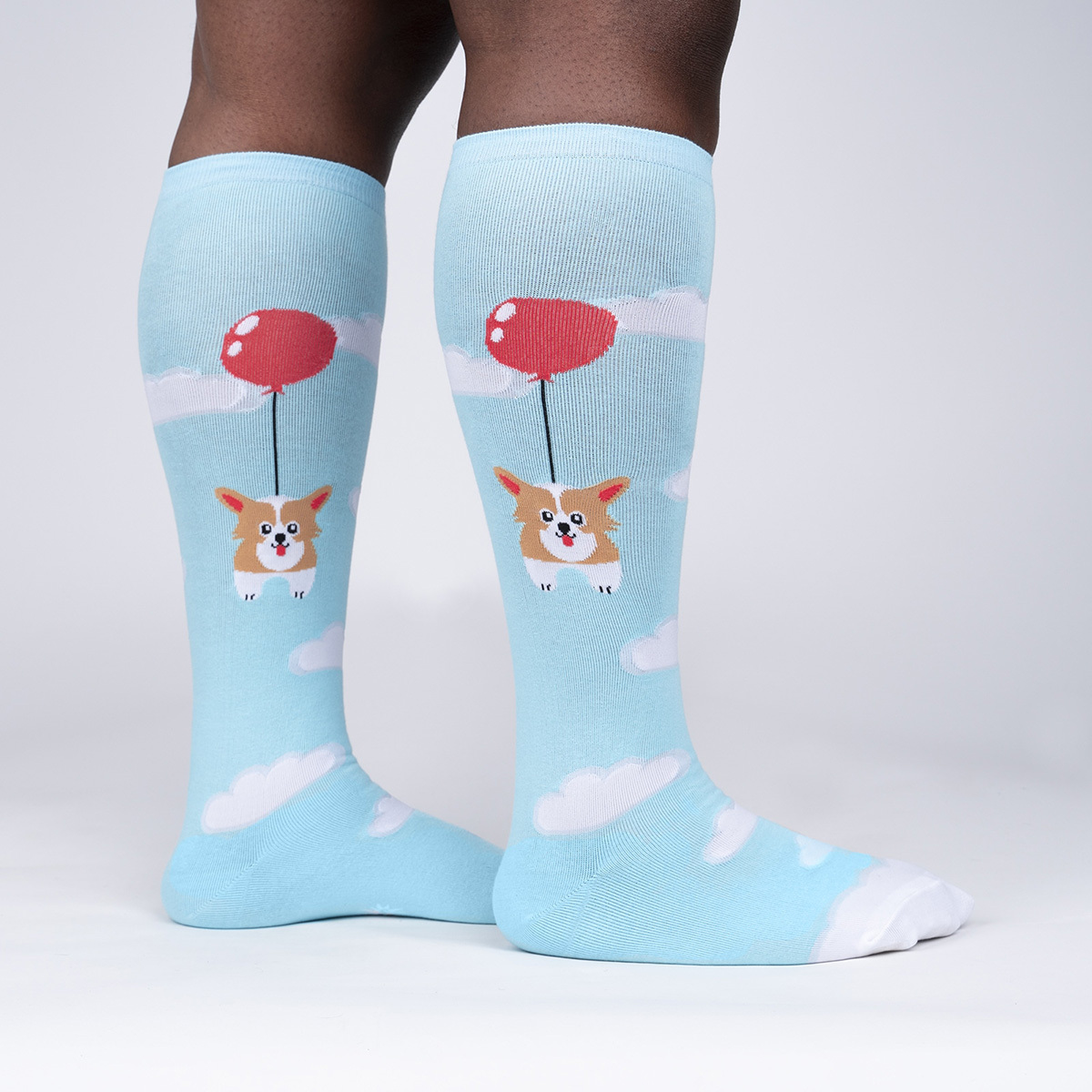 model side view of Pup Pup and Away - Funny Corgi Lover Wide Calf Socks Blue - Unisex