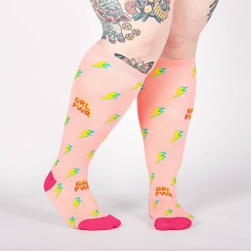 model wearing STRETCH-IT™ GRL PWR - Wide Calf - Girl Power Lightning Knee High Socks Pink - Unisex