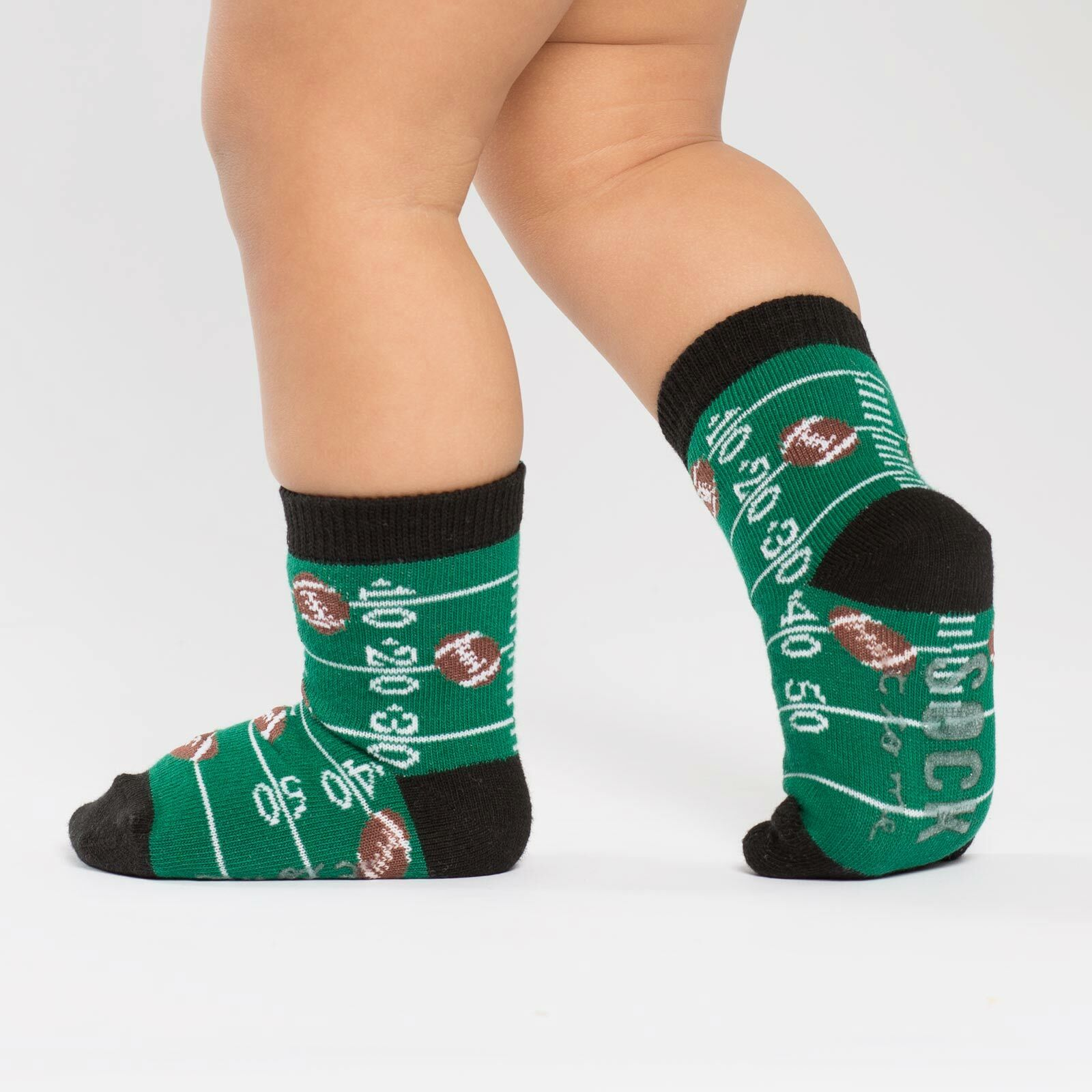 model side view of Touch Down - Football Crew Socks Green and Black - Toddler