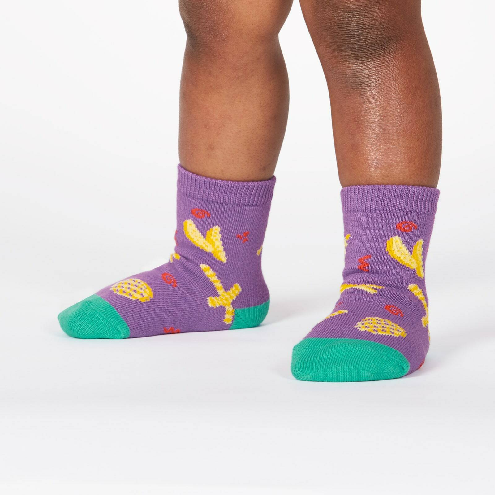 model wearing Everyday is Fry-Day - All the French Fries on Crew Socks Purple - Toddler