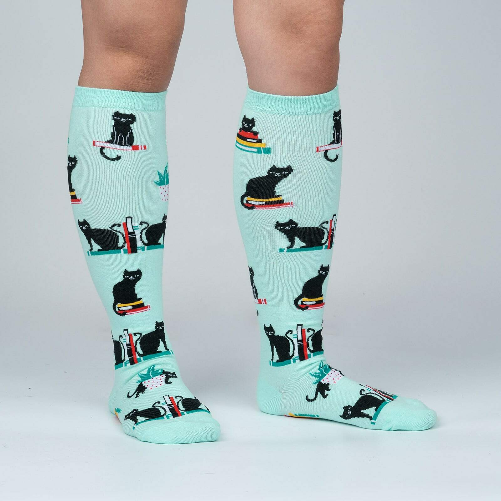 model side view of Booked for Meow - Cats and Books Knee High Socks Grey - Women's