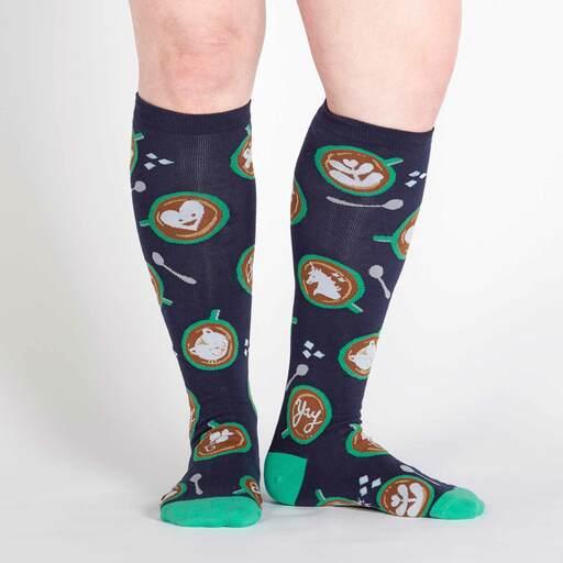model wearing Barista Artista - Mocha Art Knee High Socks - Women's