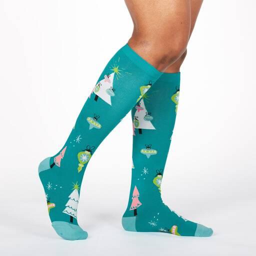 model wearing Holly Jolly Christmas - Christmas Holiday Decoration Knee High Socks Green - Women's