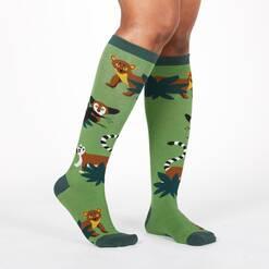 model wearing Madagascar Menagerie - Animals of Madagascar Africa Knee High Socks Green - Women's
