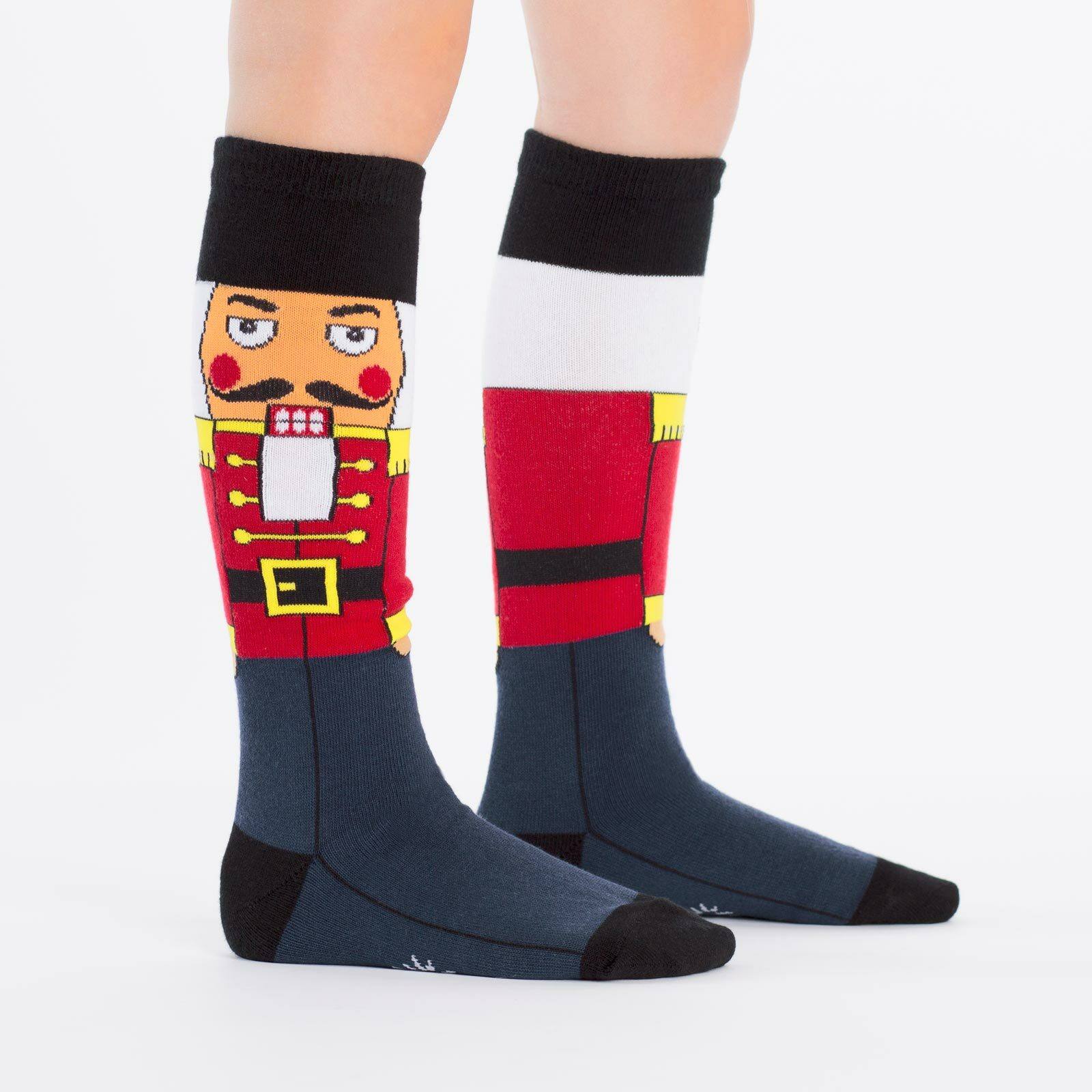 model side view of Nutcracker - Classic Holiday Wooden Nutcracker Soldier Knee High Socks Navy Blue - Youth