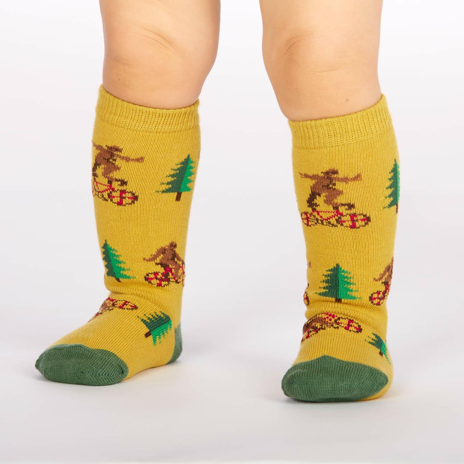 model wearing Bike Tricks - Sasquatch Knee High Socks Yellow - Toddler