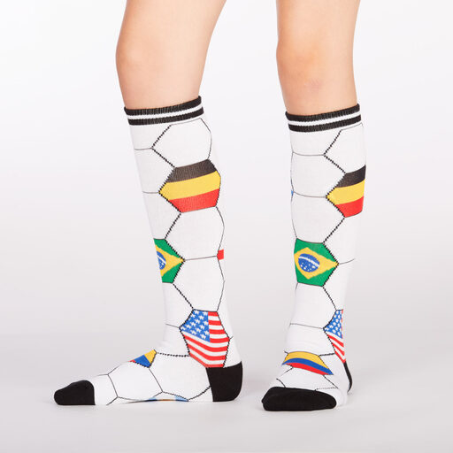 model wearing Kick It - Soccer Sport Knee High Socks White and Black - Youth