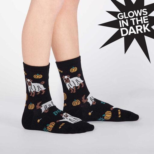 model side view of Trick Or Treat? - Glow in the Dark Ghost Dog Halloween Crew Socks Black - Junior's